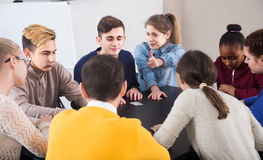 Classmates having round of Werewolf game at break between classe Royalty Free Stock Photography
