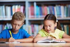 Classmates reading Stock Photos