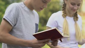 Classmates studying together outdoors, admission to university, promising future. Stock footage stock video