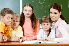 Classmates and teacher Royalty Free Stock Photos