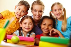 Classmates and teacher Royalty Free Stock Images