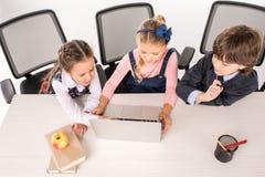 Classmates using laptop Stock Image