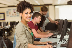 Classmates working in the computer room Royalty Free Stock Photos