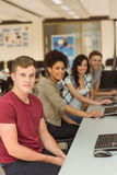 Classmates working in the computer room Stock Photography