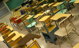 Classroom 1. Desks in an empty university classroom Stock Image