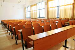 Classroom. An empty classroom with chairs and tables Royalty Free Stock Photos