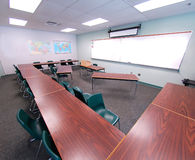 Classroom. A classroom with green chairs and brown desks Royalty Free Stock Photography