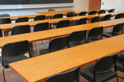 Classroom. Desks and chairs in university classroom Stock Photo