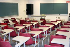 Classroom. College classroom setting with red chairs Stock Image