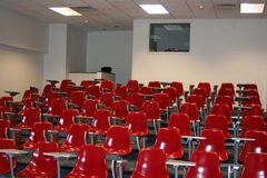 Classroom. College classroom setting with red chairs Royalty Free Stock Photo
