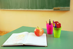 Classroom. Back to school - classroom desk with a book and apple Royalty Free Stock Photos