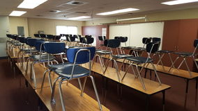 Classroom. A classroom with all of the chairs on the desk for cleaning Stock Image