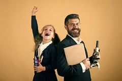 Classroom and alternative education concept. Kid and dad hold microscope Royalty Free Stock Photo