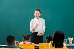 In classroom, Asian teacher teaches student royalty free stock photography