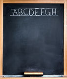 Classroom blackboard. With alphabet and blank space Royalty Free Stock Photography