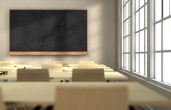 Classroom board. Classroom with desks and blackboard with focus on the blackboard royalty free stock photos