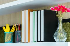 Book shelf with books flower and pencil. Classroom book shelf with books flower and pencil royalty free stock photos