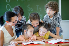 Classroom. Children with teacher in classroom royalty free stock photos