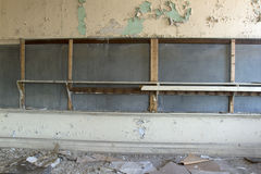 Classroom in decay. With chipping, peeling paint over a chalkboard Royalty Free Stock Photography