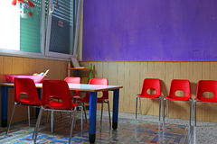 Classroom with desks and red chairs Royalty Free Stock Photography