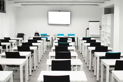 Classroom empty. High school or university desk or table with a pen on top stock photo