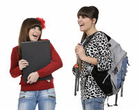 Classroom friends. Two friends with a backpack and a book posing Royalty Free Stock Photos