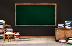 Classroom, green blackboard on black wall with table, chair and piles of books on concrete floor, 3d rendered