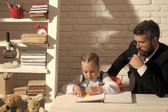 Classroom and home education concept. Man and kid stock photos