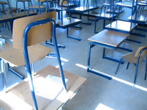 Classroom II. Empty classroom with chairs on tables Stock Images