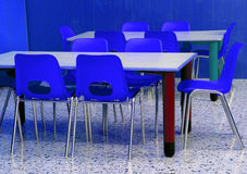Classroom of a kindergarten with blue chairs Stock Photography