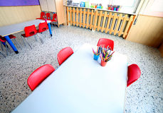 Classroom of kindergarten with desks and small chairs Royalty Free Stock Photography