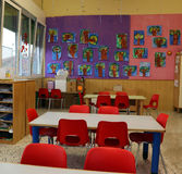 Classroom of a kindergarten with red chairs Royalty Free Stock Photography