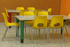 Classroom of a kindergarten with yellow chairs Royalty Free Stock Photography