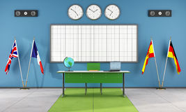 Classroom of a language school. With teacher's desk and flags - rendering Royalty Free Stock Image
