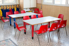 Classroom nursery with chairs and desks for children Stock Photography