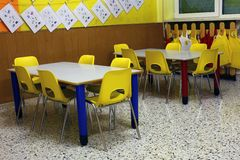 Classroom of a nursery with the little yellow chairs. Classroom of a preschool with the little yellow chairs Stock Photography