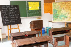 Classroom with old desks, board, and map Royalty Free Stock Photo