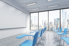 A classroom or presentation room in a modern university or fancy office. Blue chairs Stock Image