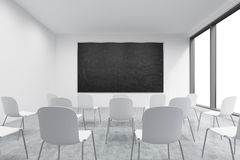 A classroom or presentation room in a modern university or fancy office. White chairs, panoramic windows with white copy space and Stock Photo