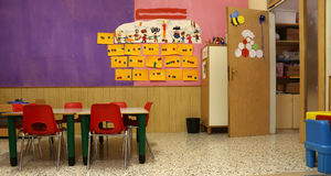 Classroom with red chairs and tables Stock Photos