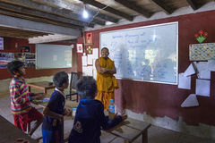 A classroom in the rural Lolei village, Cambodia. Lolei, Cambodia - January 04, 2017: A classroom in the rural Lolei village during an english lesson. The Stock Photography