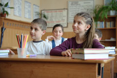 Classroom scene. Pupils aged 11 sitting at the desks in classroom Royalty Free Stock Images
