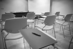 Classroom with School chairs and desk Stock Images