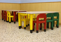 Classroom of a school with colorful chairs and small tables Royalty Free Stock Photography