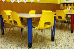 Classroom of a school with the little yellow chairs Royalty Free Stock Photography