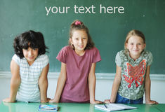 Classroom at school and text on green board Stock Image