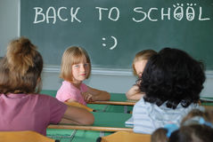 Classroom at school and text on green board Royalty Free Stock Photos