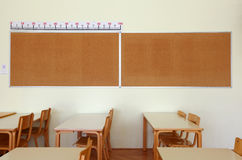 Classroom with tables and board Stock Photos