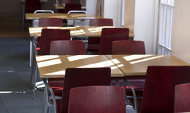 Classroom tables with red chairs Stock Image