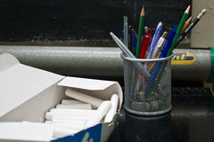 Classroom tools: chalk and pencils Stock Image